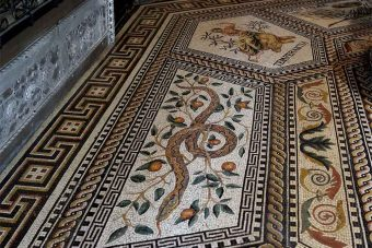 "mosaic floor, after restoration with new made picture of the snake and new made ""Temperantia"""